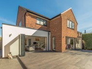 Rear elevation transformed with aluminium windows timber cladding and white render