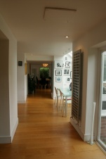 Hallway with dining area created with bay window extension