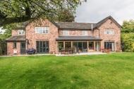 Single storey extension with oak frame and aluminium glazing