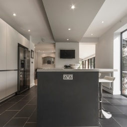 Kitchen island with feature ceiling and wall