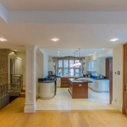 Wide oak planks in open plan kitchen