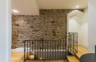 Wrought iron balistrading and exposed stone wall