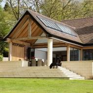 Single storey rear extension Alderley Edge with raised patio area.