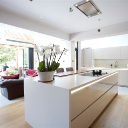 Kitchen island and banquette seating for dining area