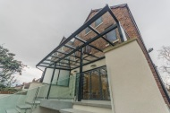 Raised terrace with glass canopy