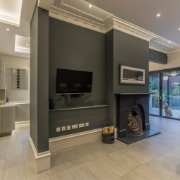 Existing fire place and cornicing retained