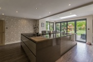 Large kitchen island with breakfast bar