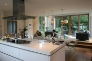 OPen plan kitchen dining with raised sitting area