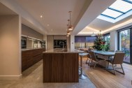 Open plan living, kitchen dining room with home office space.